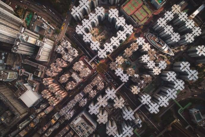 aerial view of multiple city blocks with tall buildings representing technical experts, engineers, seller-doer sales model