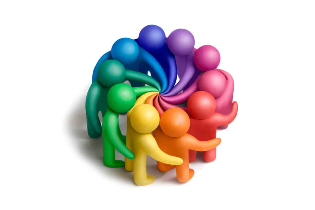 20 qualities of leadership represented by Multicolored plasticine human figures concluding an agreement on a white background